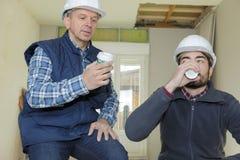 Builders having coffee break Stock Photos