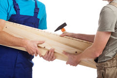 Builders holding timber Royalty Free Stock Photo