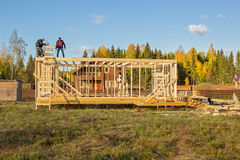 builders install a wooden frame of house Royalty Free Stock Photography
