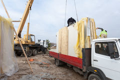 Builders Installing Frame House Structural Insulated  SIP Panels. Building New Frame House. Royalty Free Stock Photos