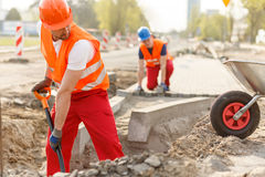 Builders and paving Royalty Free Stock Photos