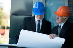 Builders planning the job Stock Images