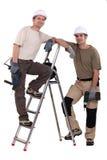 Builders with powertools Stock Photo