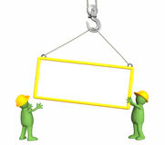 Builders - puppets, lowering a frame on a hook Royalty Free Stock Photography