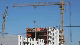 Builders put the brickwork. The construction site. The construction of the high-rise residential building. Builders put the brickwork. Construction crane stock video footage