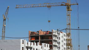 Builders put the brickwork. The construction site. The construction of the high-rise residential building. Builders put the brickwork. Construction crane stock video