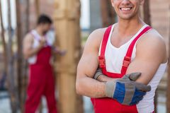 Builders in red work dungarees Stock Image