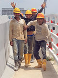 Builders are rejoicing to someone on the street in Stock Photo
