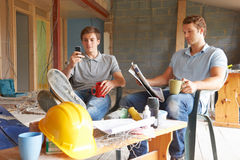 Builders Relaxing During Break On Site Stock Images