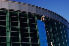 Builders repair facade on the crane Royalty Free Stock Image