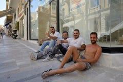 Builders resting in street in Heraklion, Crete Royalty Free Stock Photo