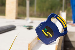 Builders retractable tape measure on site Royalty Free Stock Image