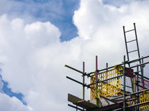 Builders scaffolding against sky Stock Images