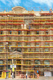Builders on scaffolding for restoration ancient stock photo