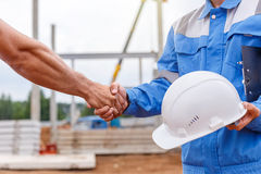 Builders shaking hands Royalty Free Stock Photo