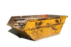 Builders skip. Old yellow builders skip, Isolated on white, Clipping paths for skip and shadow stock image