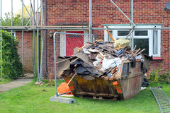 Builders skip. renovations, house repairs. Stock Photo