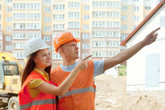 Builders standing at building site Stock Images