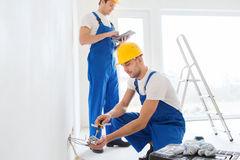Builders with tablet pc and equipment indoors Stock Photos