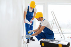 Builders with tablet pc and equipment indoors Stock Photography