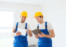 Builders with tablet pc and equipment indoors Stock Photo