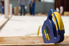 Builders tape measure on a building site Royalty Free Stock Photo