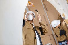 Builders using chisel and hammer. Builders are using a chisel and hammer royalty free stock photos