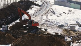 Builders using an excavator build a sewage system for the apartment building. Timelapse stock footage video stock footage