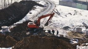 Builders using an excavator build a sewage system for the apartment building. Timelapse stock footage video stock video