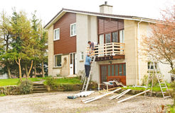 Builders at work: home improvements. Royalty Free Stock Photos