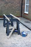 Builders workbench. A builder's workbench outside a building, with sawdust on the paving stones Royalty Free Stock Photography