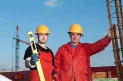 Builders workers at construction Stock Images