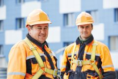 Builders workers at construction site royalty free stock photos