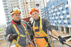 Builders workers at construction site royalty free stock photography