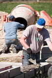 Builders working. Two builders working on a construction site stock photography