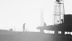 Builders working on the construction site, erecting and concrete reinforcement Stock Images