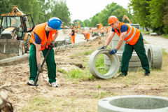 Builders working hard. Photo of two builders working a road stock photos