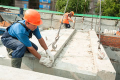 Builders working on residental house construction Stock Photo