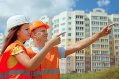 Builders  works on the building site Royalty Free Stock Image