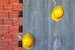 Builders yellow hard hats. On a construction site Royalty Free Stock Image