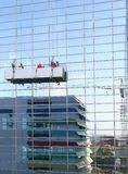 Building. Window cleaning service on glass building royalty free stock photography