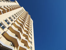Building. City, multistory dwelling-house on a background blue sky Stock Photo