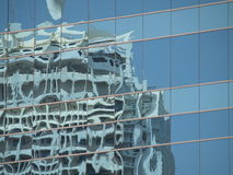Building 21. Distorted reflection of a building on the windows of a skyscrape Royalty Free Stock Photography