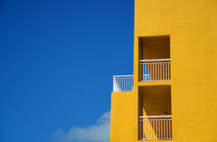 Building. Photo of yellow building with balcony against blue sky Royalty Free Stock Photography