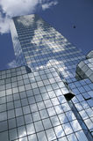 Building. Blue sky and clouds reflected in the glass building in Warsaw (Poland Royalty Free Stock Photography