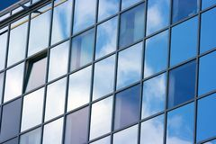 Building. Detail of a modern office building with sky reflection Royalty Free Stock Image