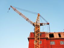 Building. The building crane stands near a builded house Stock Photography