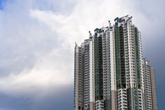 Building. A tall residential building against a slight cloudy sky stock photography