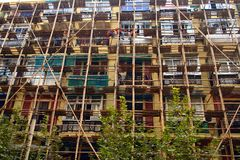 Building. Scaffolding outside a building using wooden poles Royalty Free Stock Images