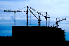 Building. Black silhouettes of building cranes Stock Image